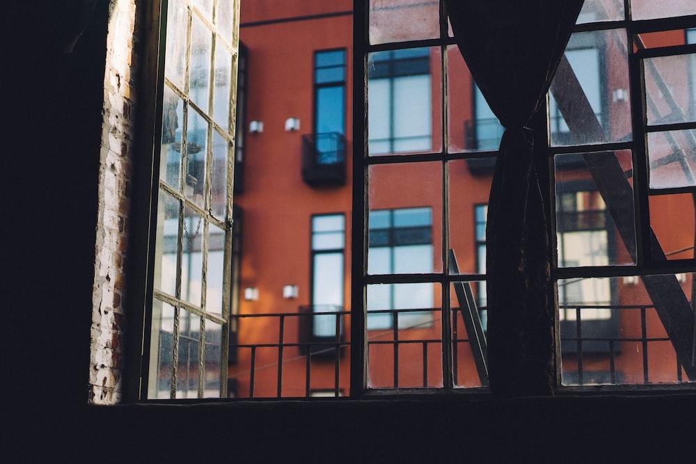 minimalist photo of glass window with building view