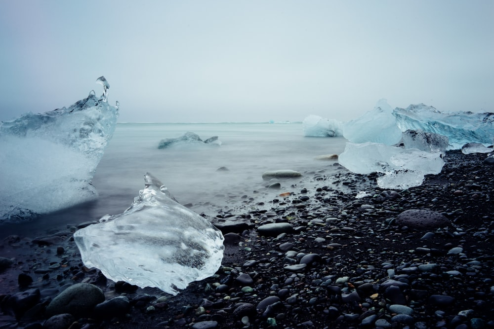 ice blocks on black stone fragment