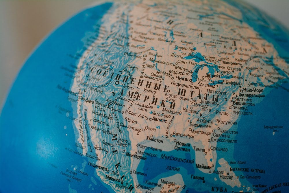 blue and brown world globe