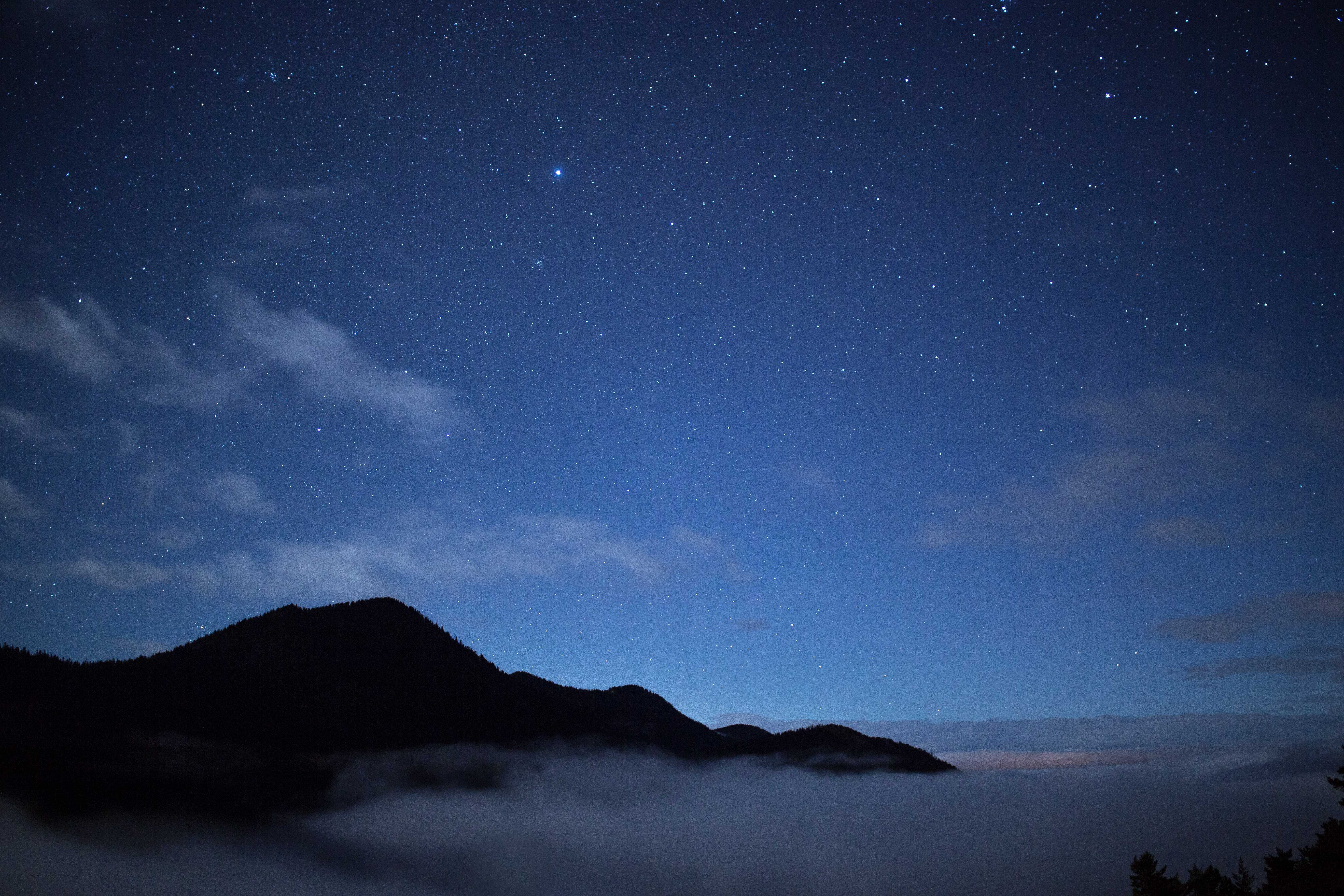 mountain and clouds during nighttime