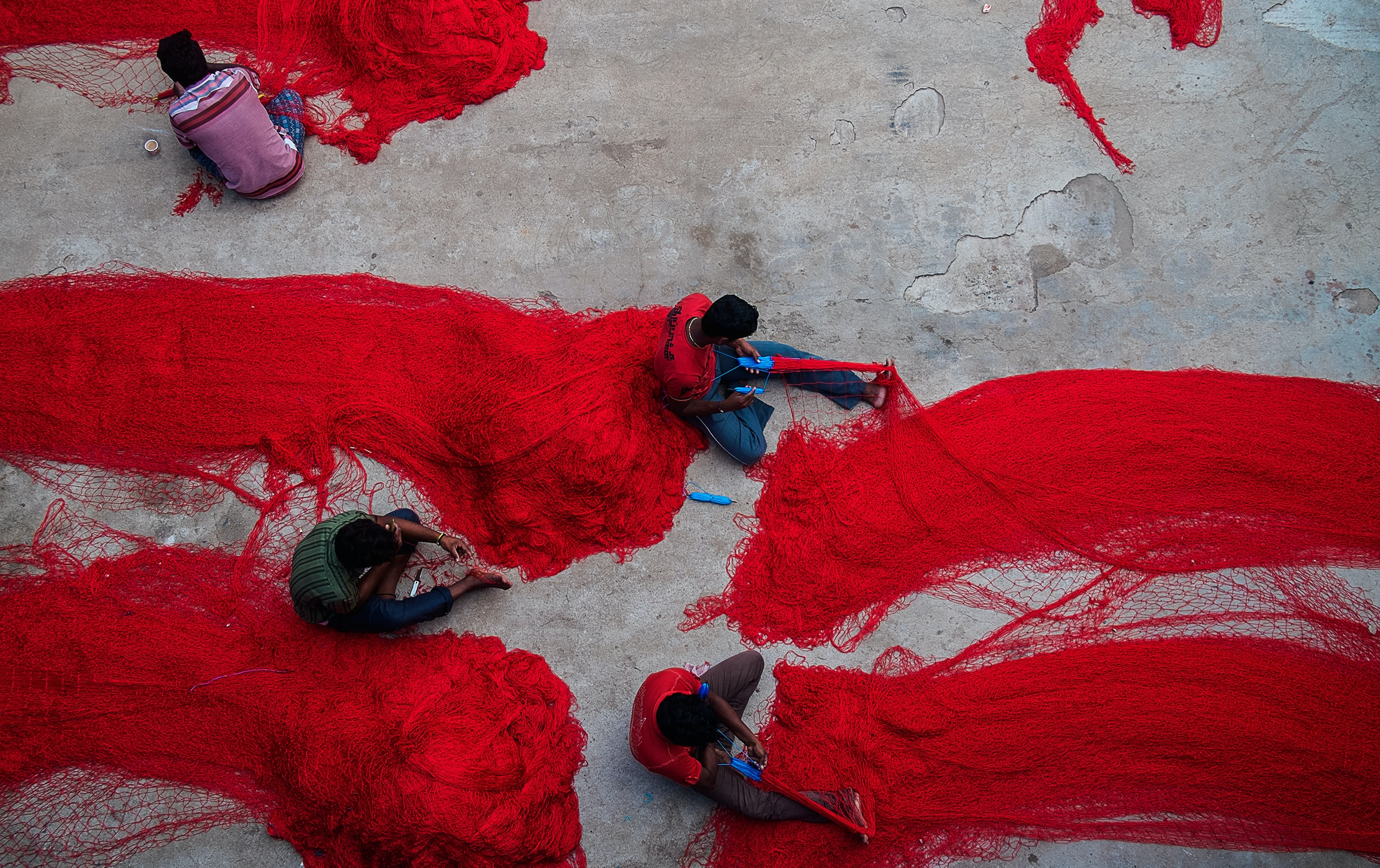 group of people holding red nets