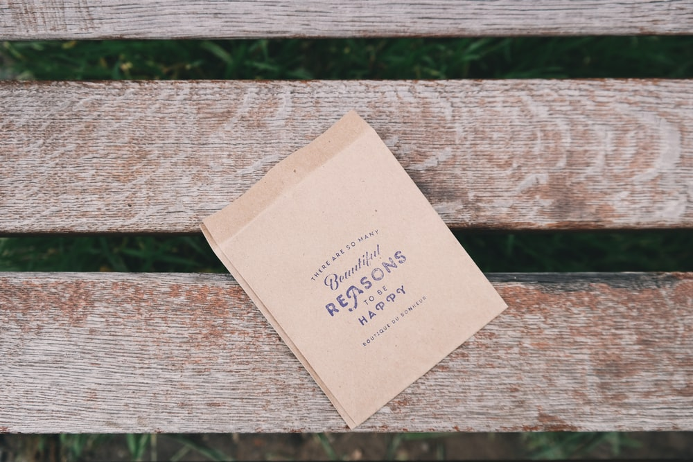 brown printing paper on brown wooden bench