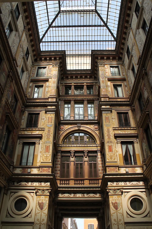 photo of brown concrete building interior