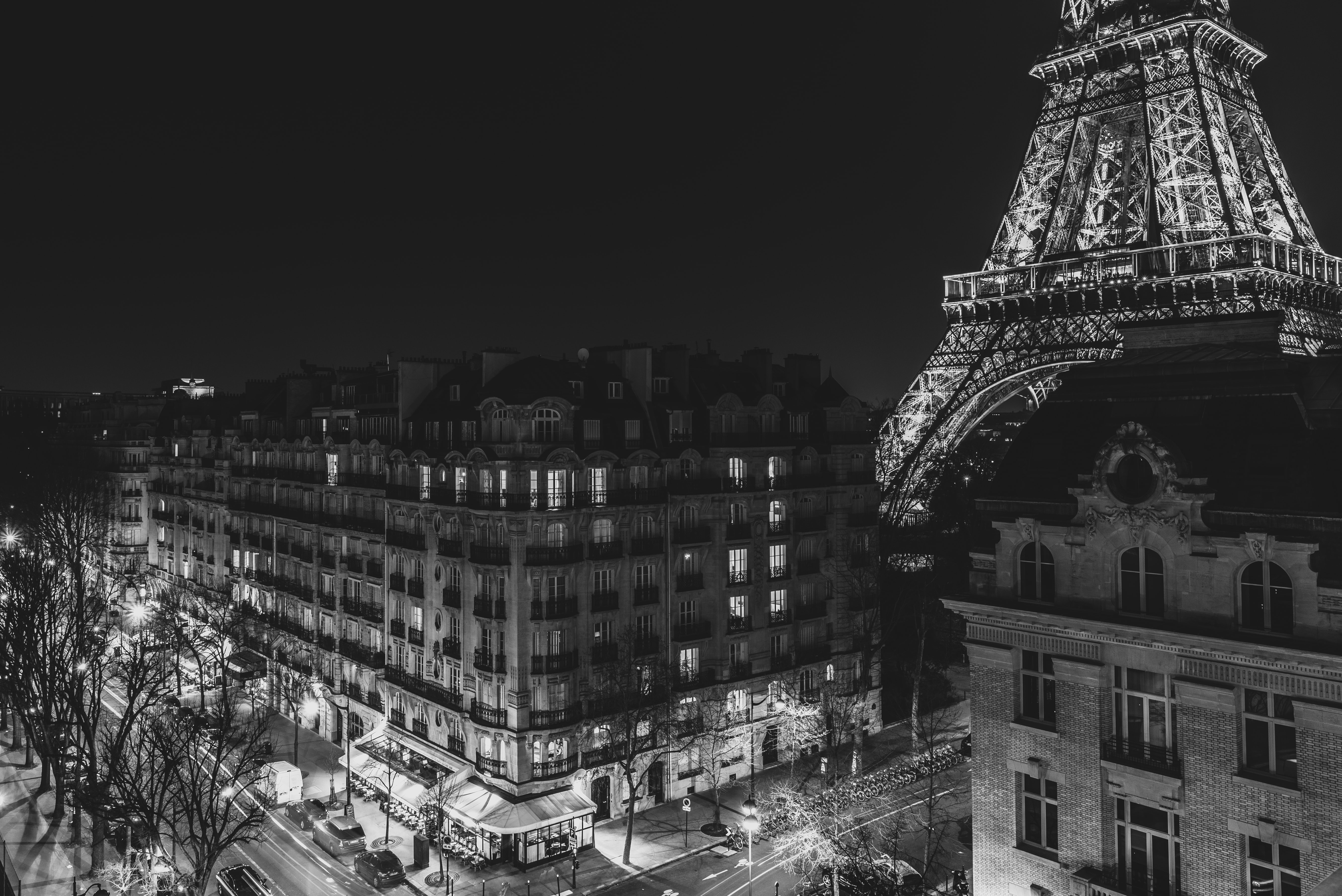 A black and white photo showing large buildings in France.