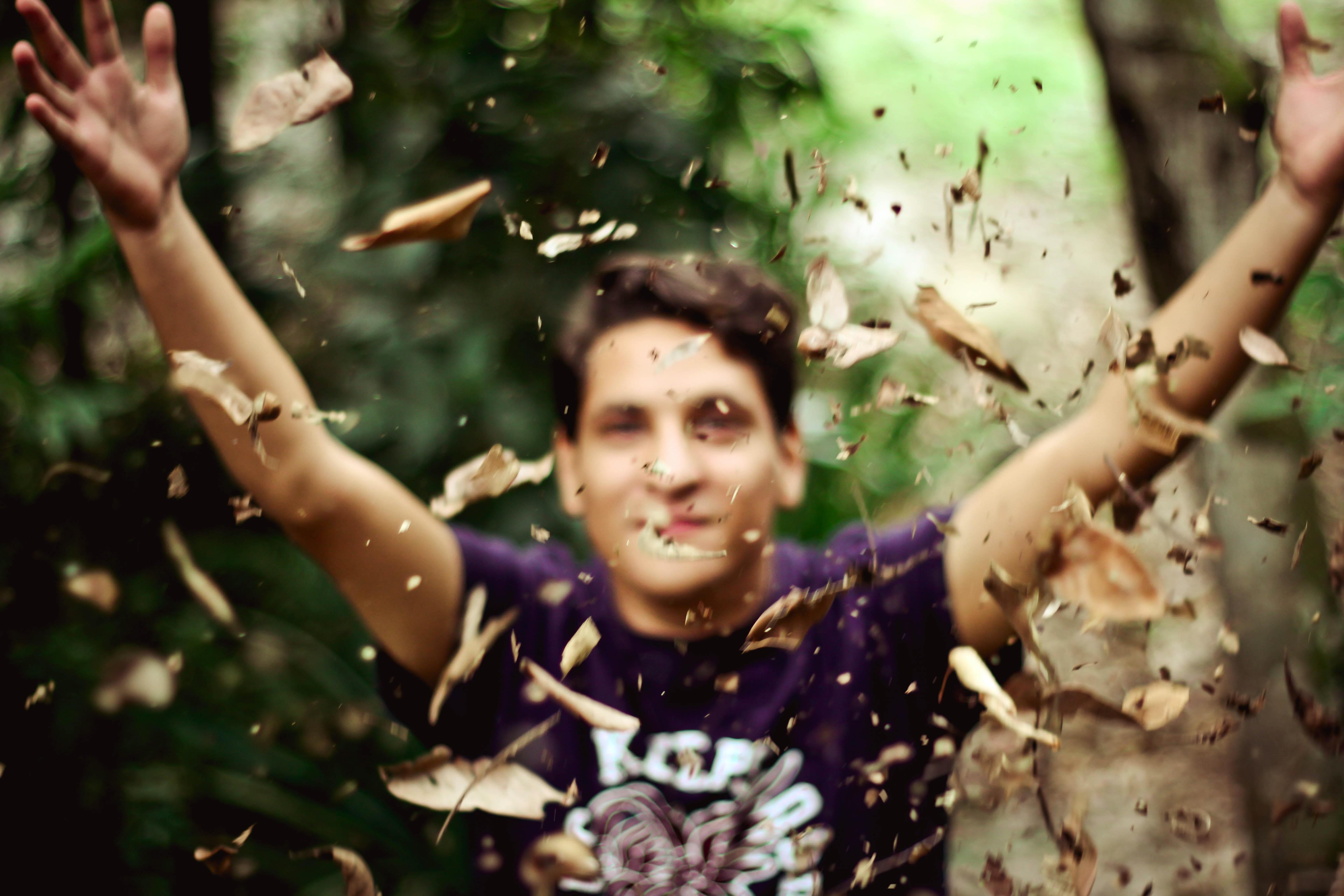 man in purple crew-neck T-shirt photography
