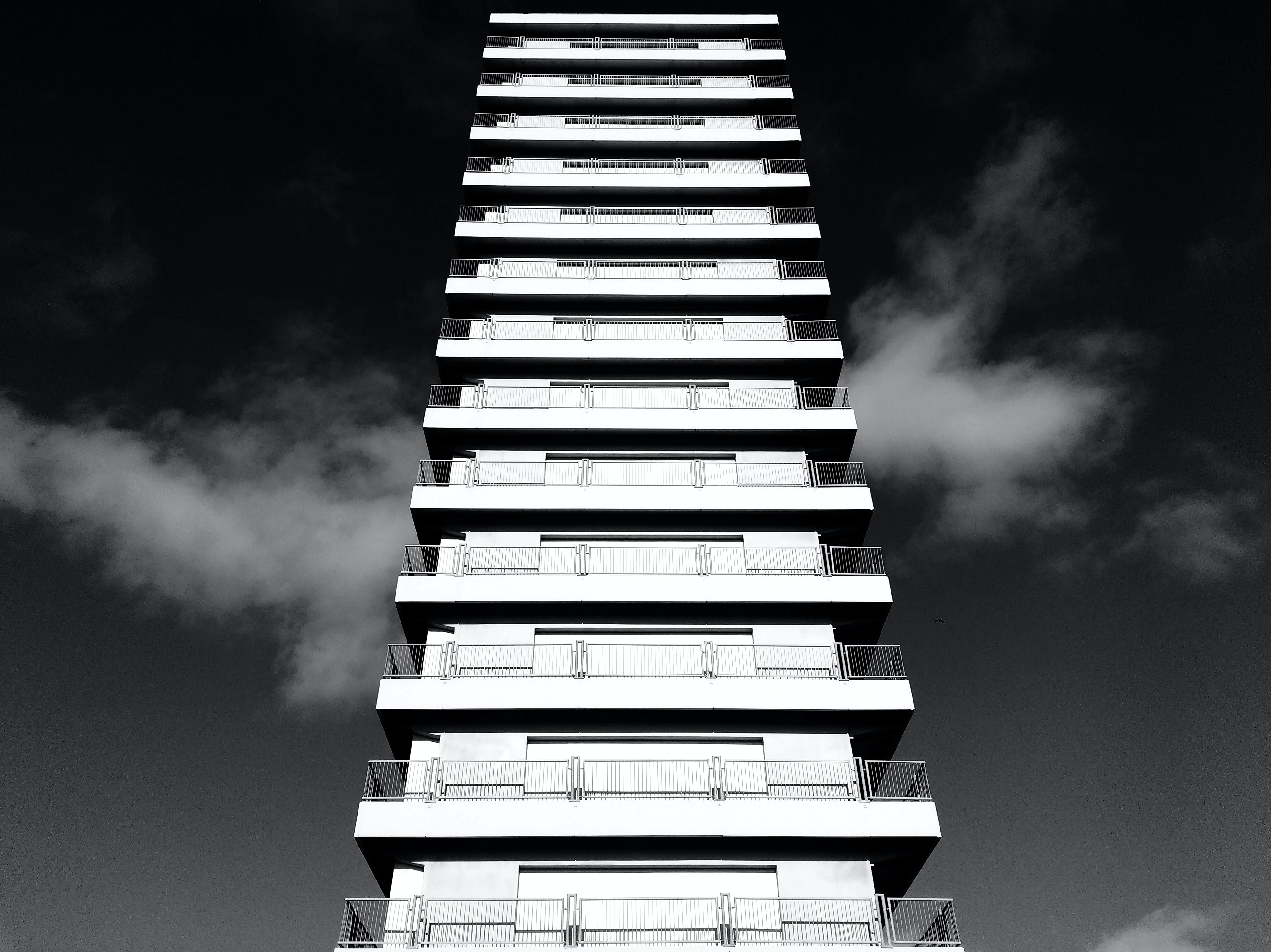 concrete building in gray scale photography