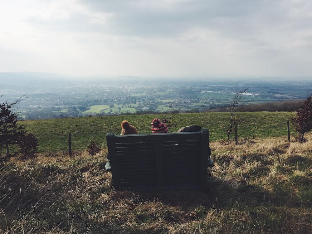 two children sitting on bench