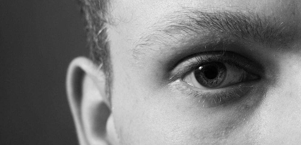 grayscale photography of person's right eye