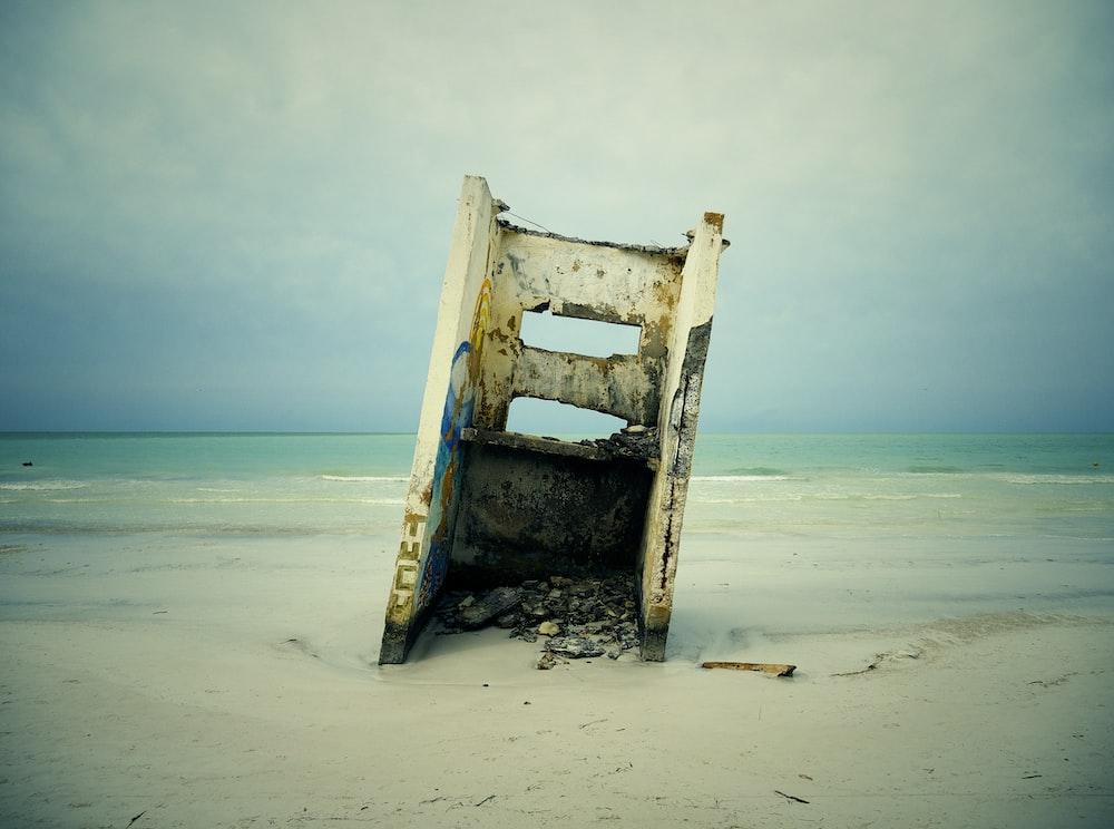 white steel frame near beach shore during daytime