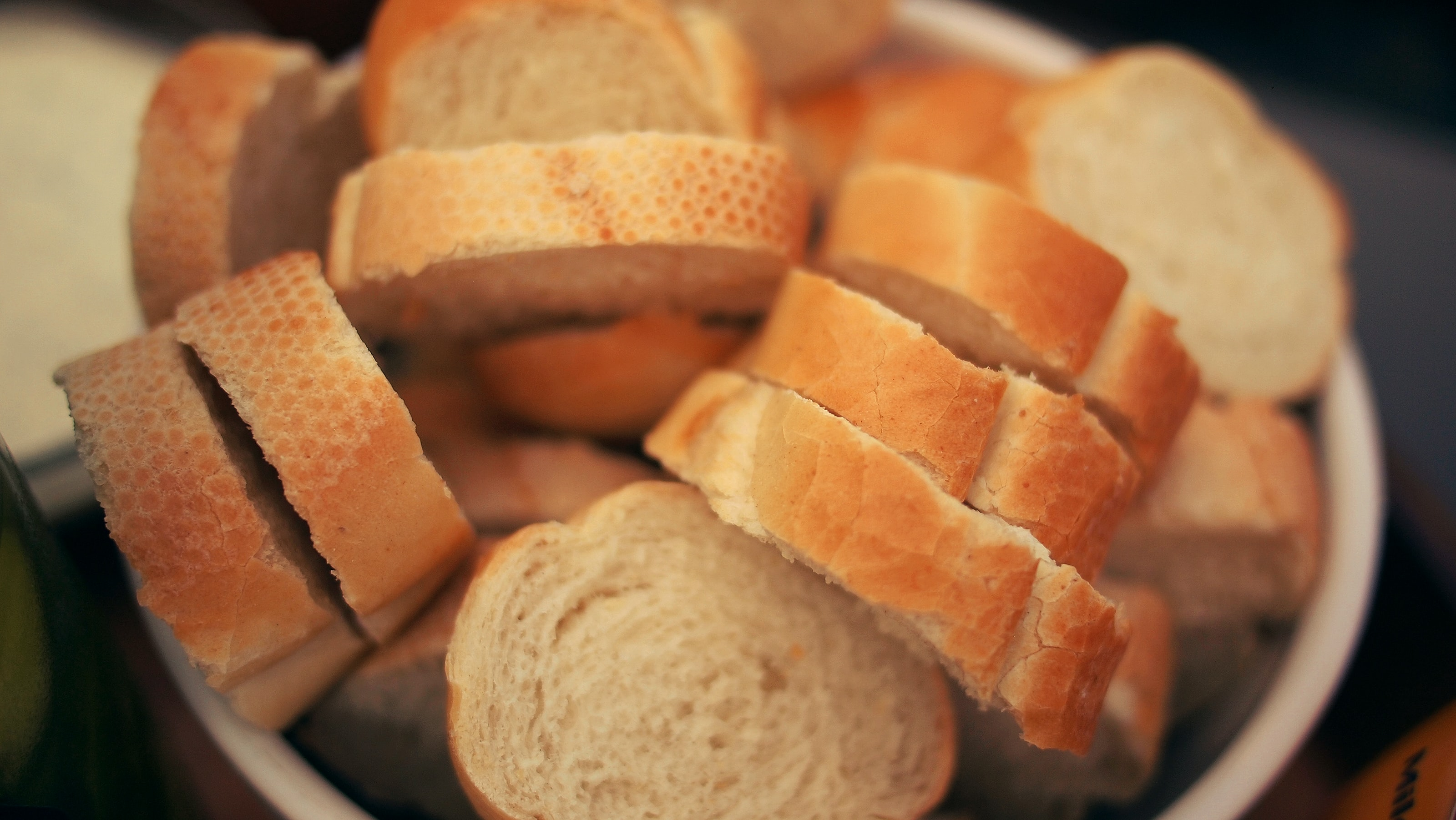 Basket of sliced french bread on the table at a restaurant