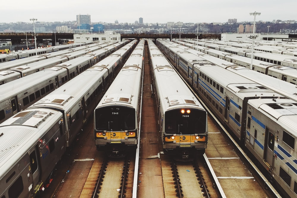 white train lot on railway during day time