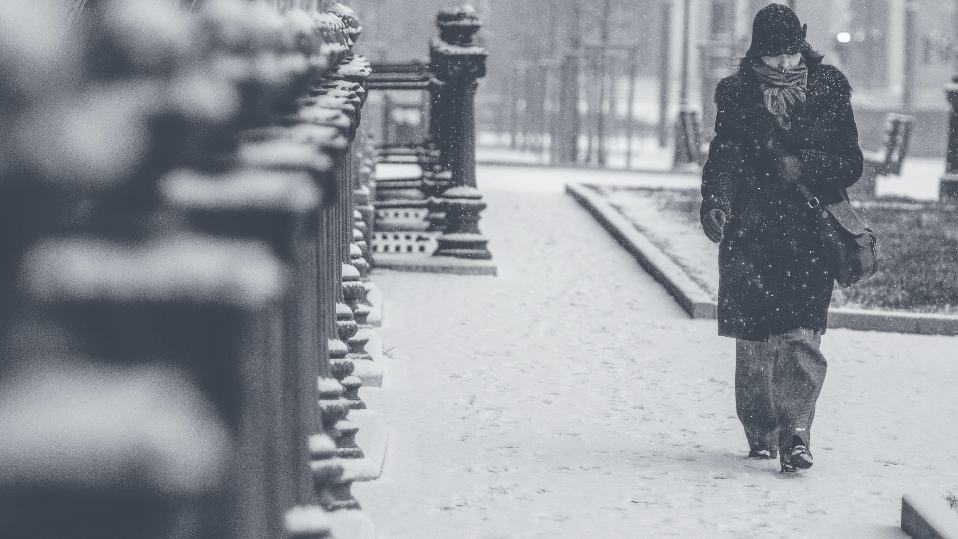 A woman walking the street in Budapest on a snowy day