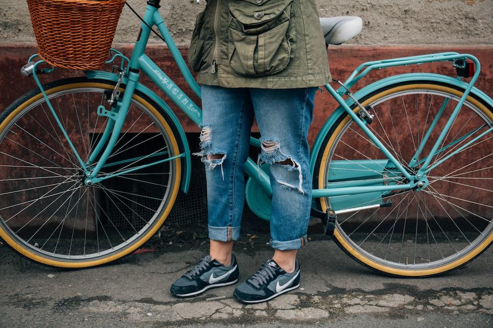 person standing beside bike