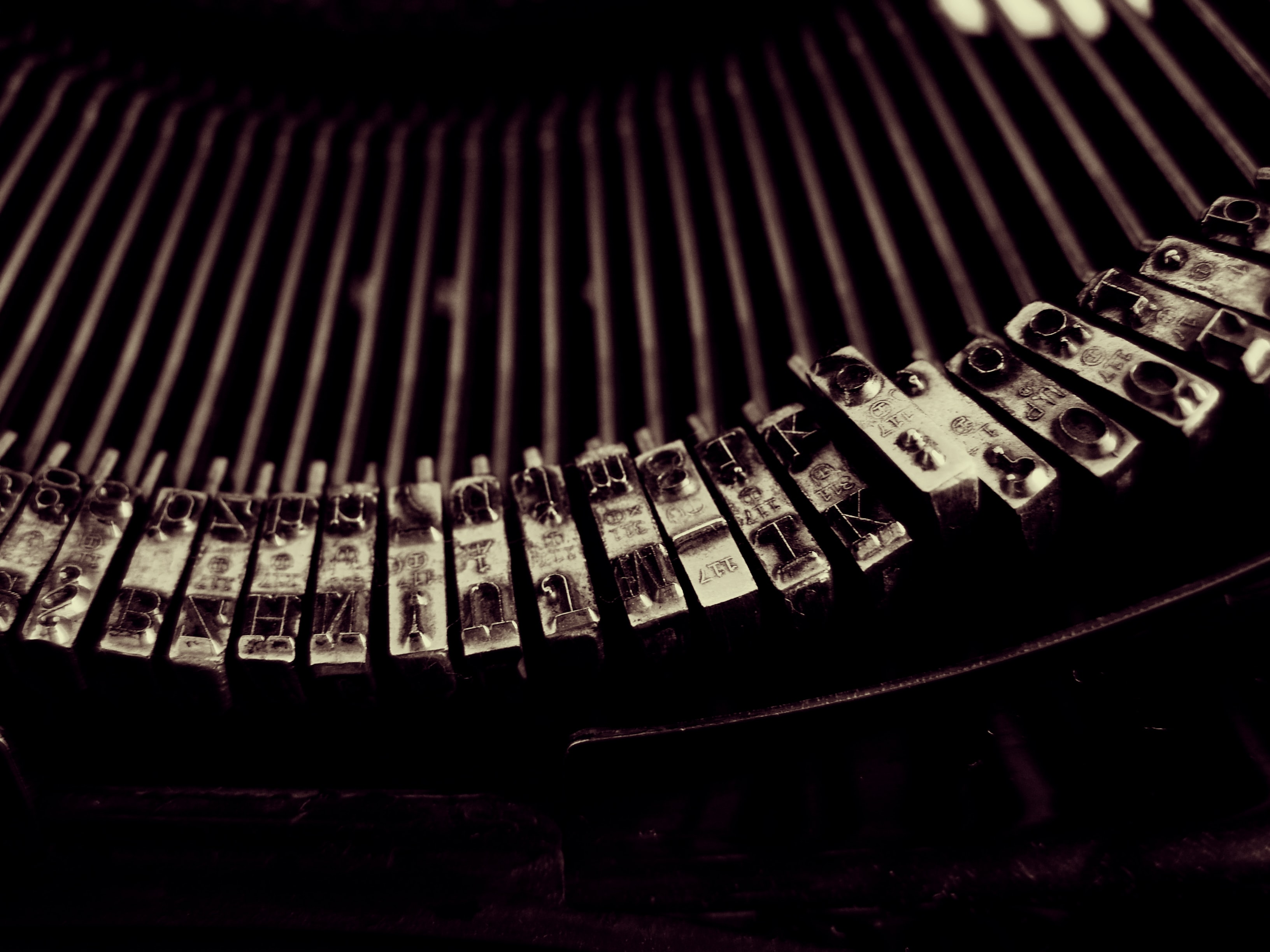 Close-up of typebars in a typewriter