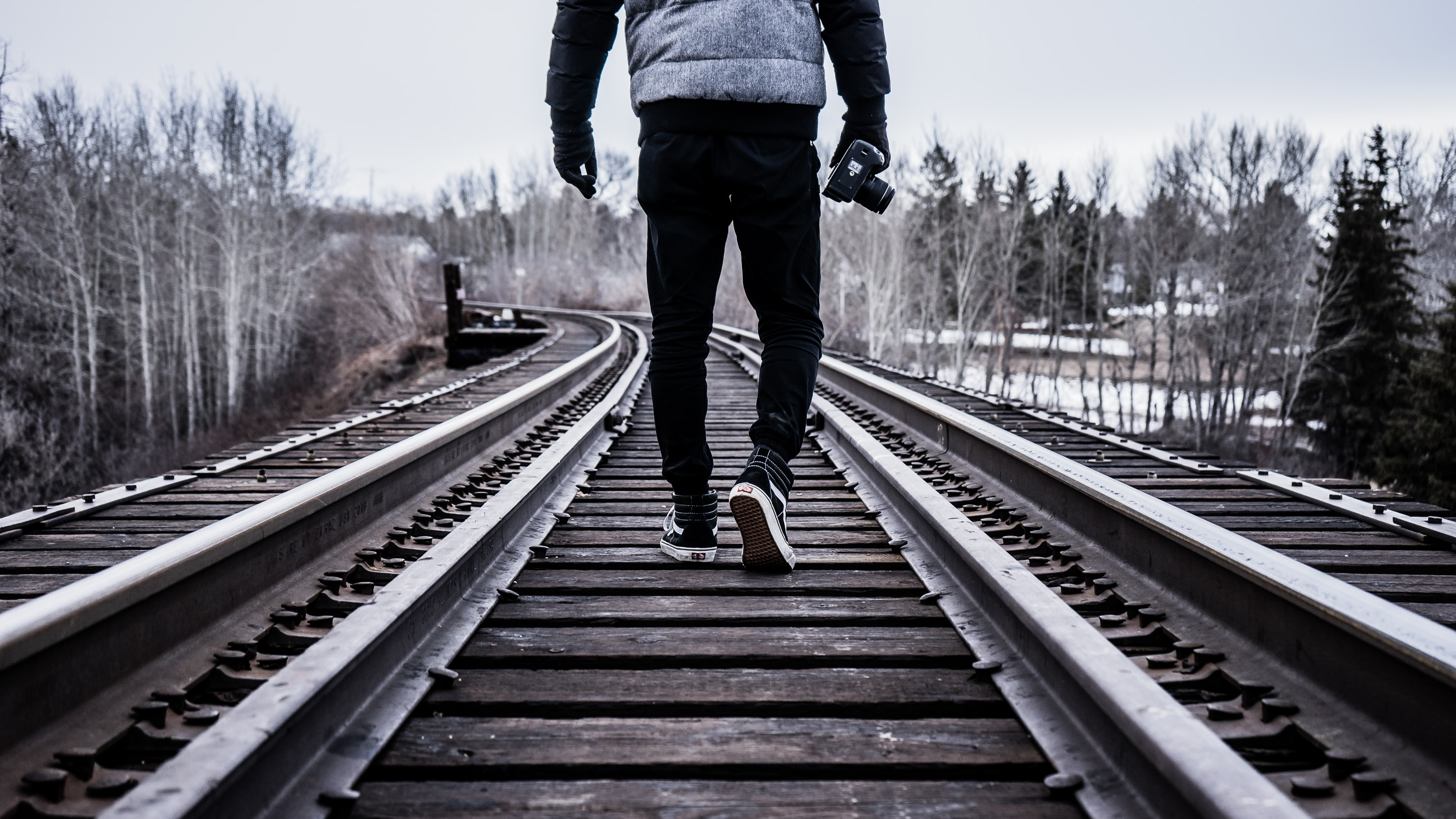 man waking on train rail