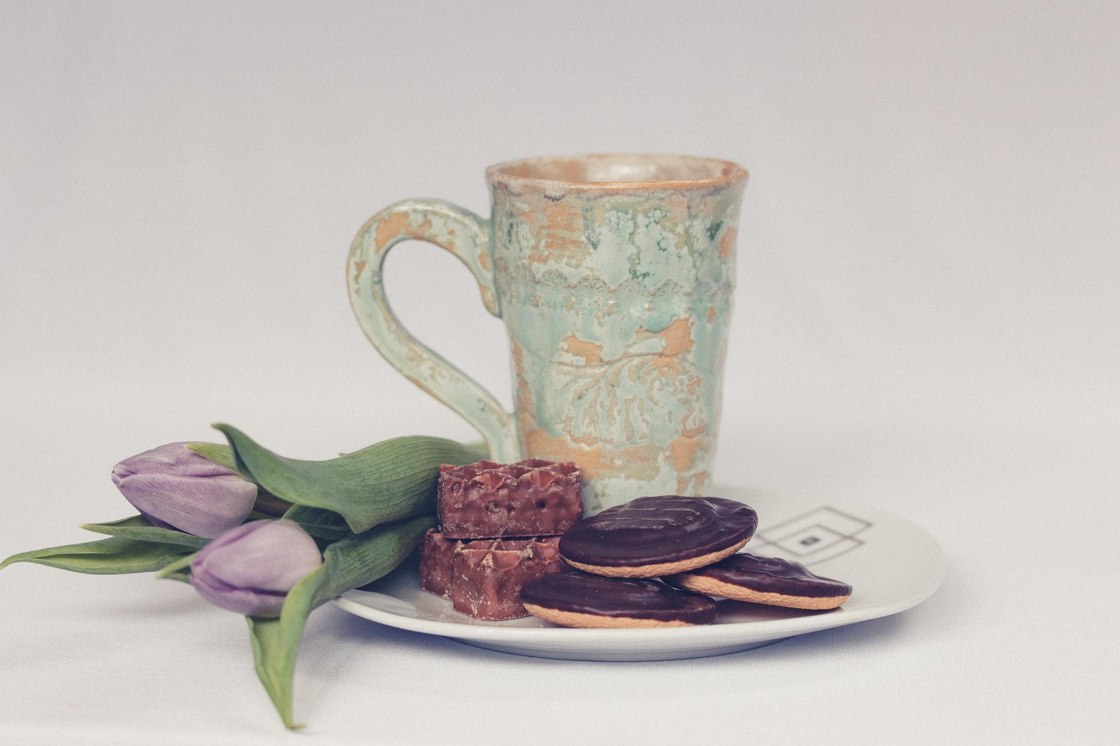 cookies beside ceramic mug