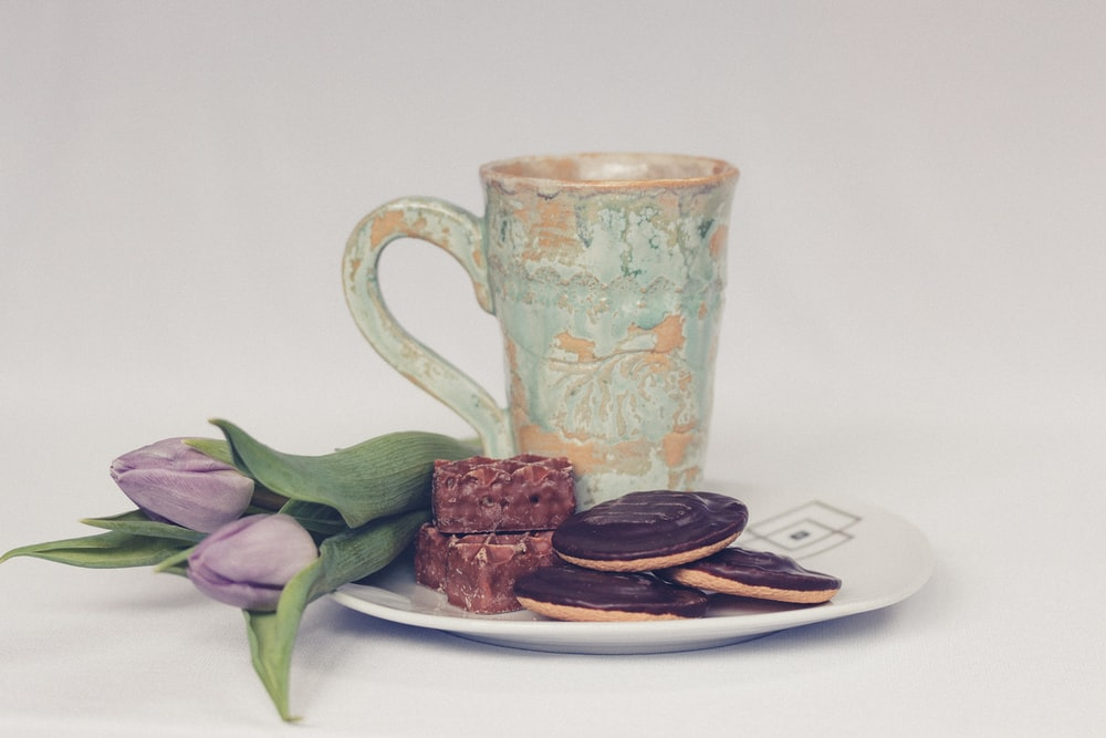 cookies beside ceramic mug