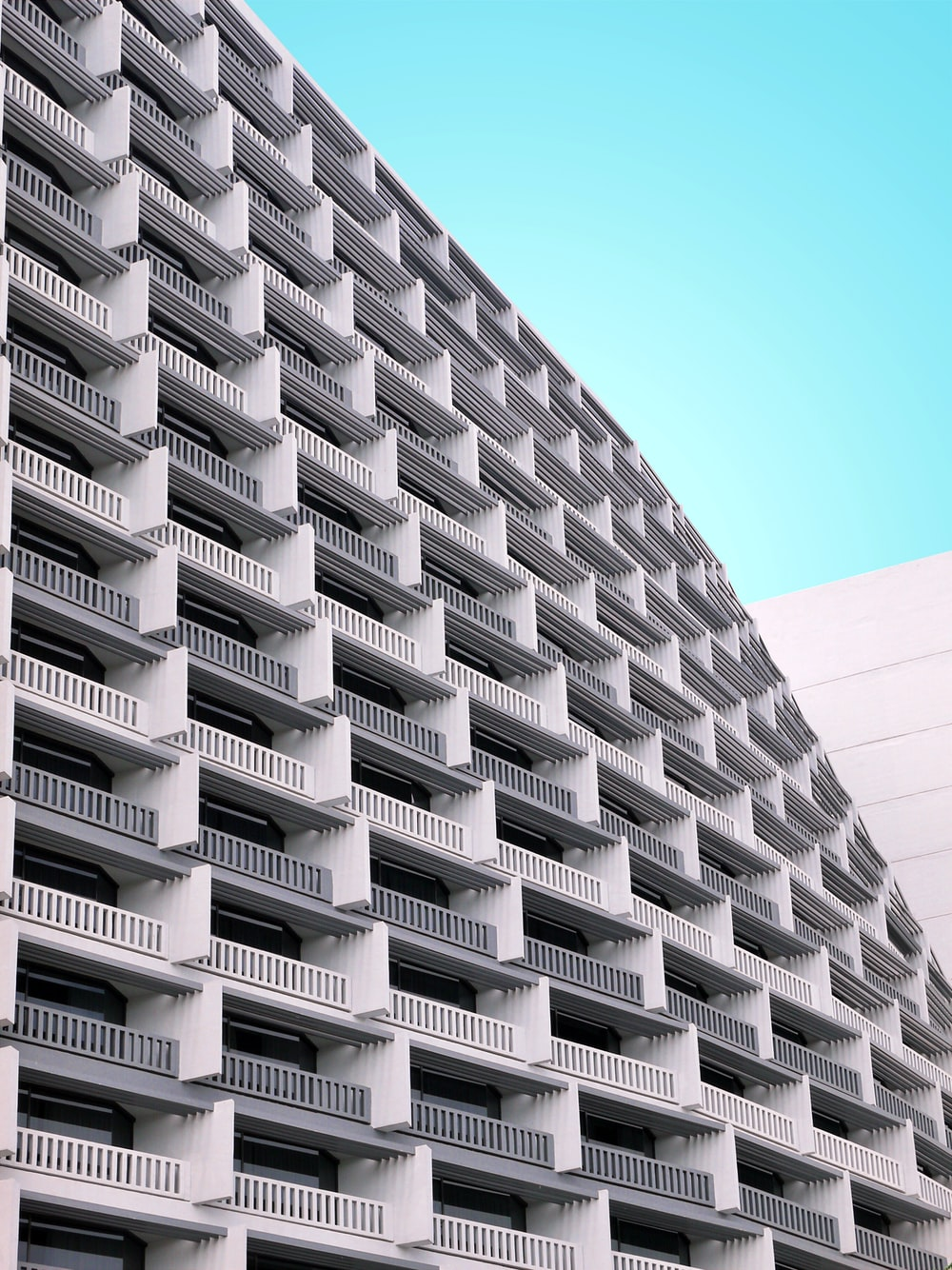 white concrete building with terraces