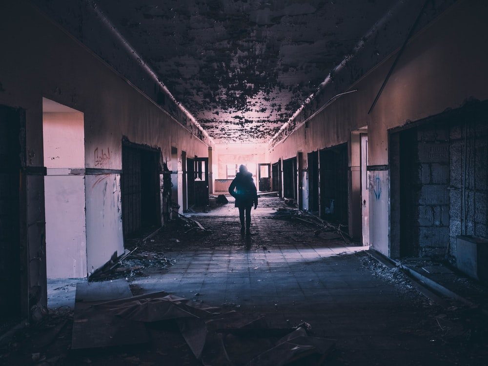 person walking on hallway of building