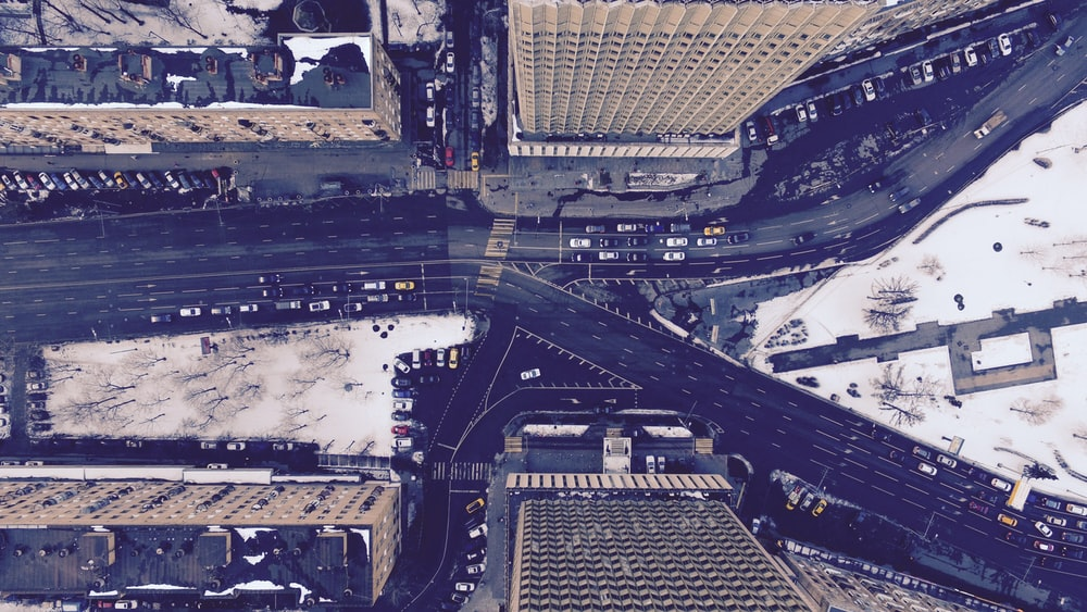 aerial photography of road between buildings