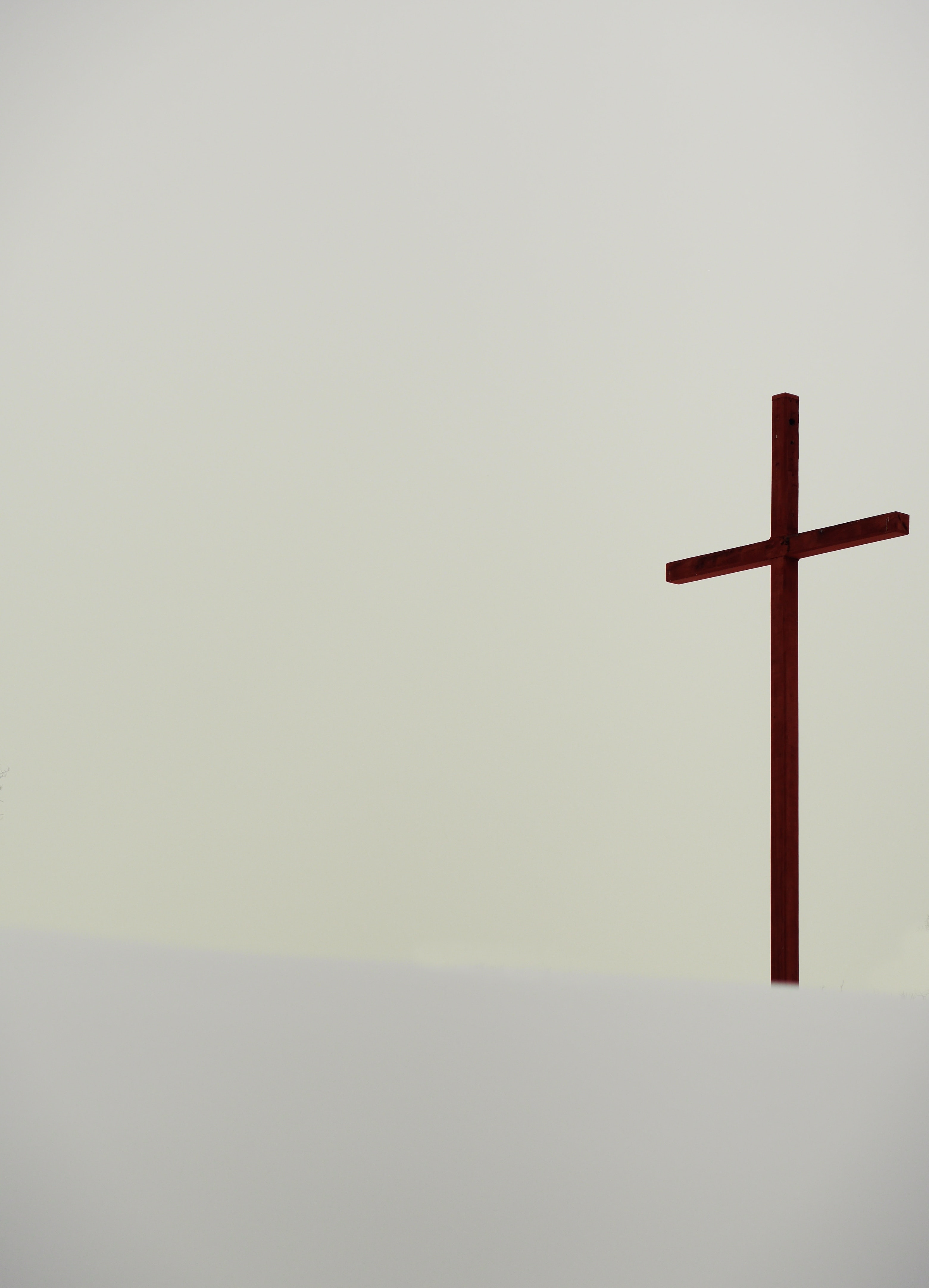 A tall cross statue in the backdrop.