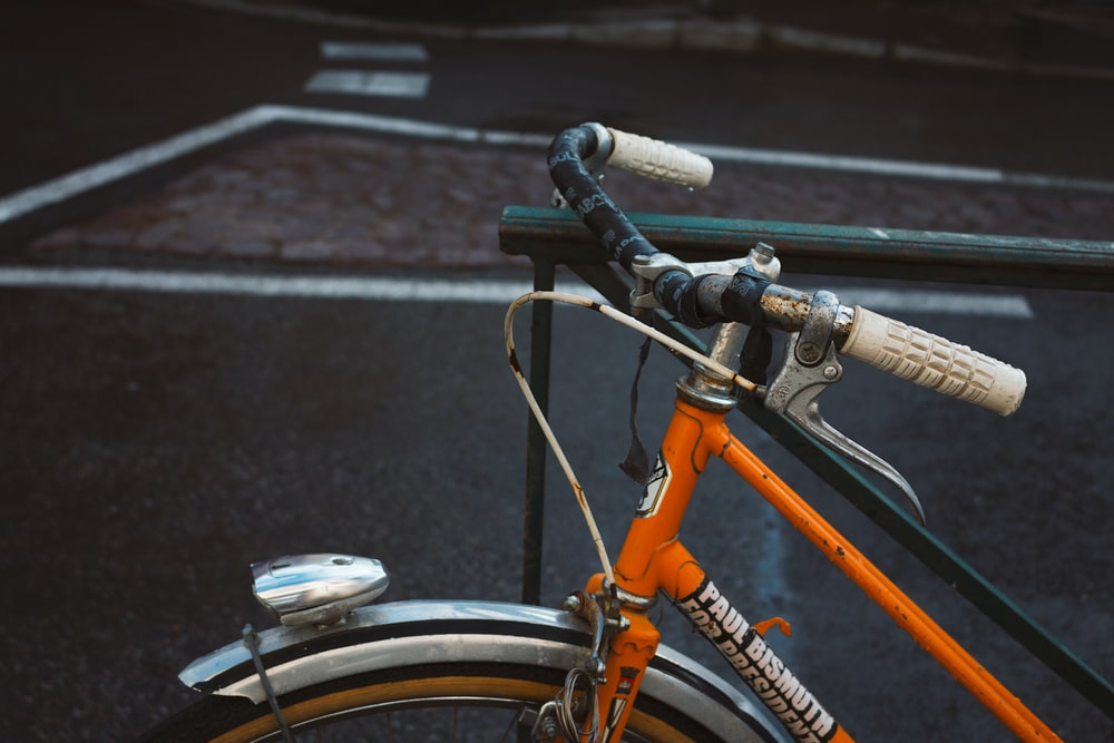 bicycle locked into steel rail