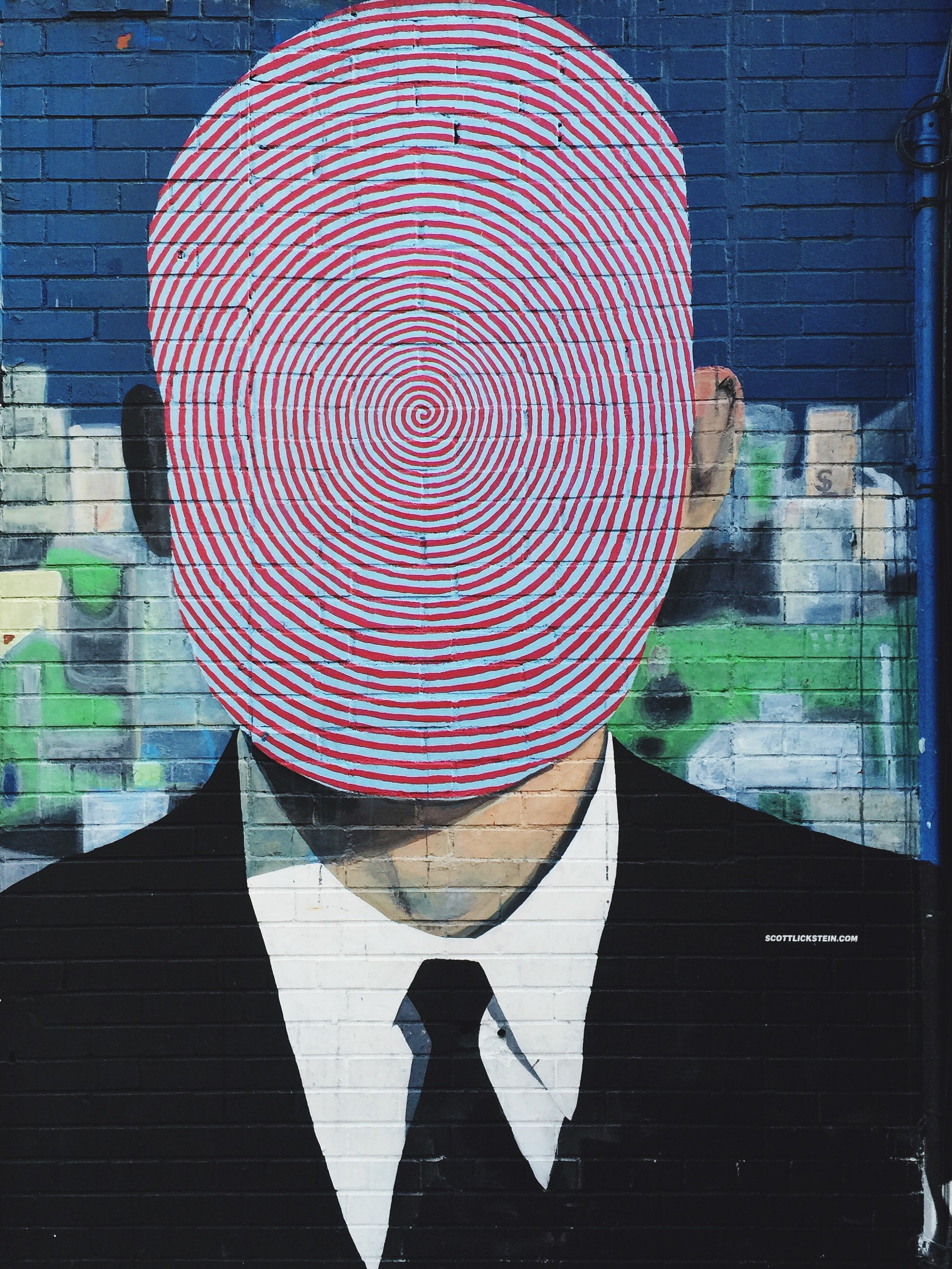 A businessman with a fingerprint stamped over his head.