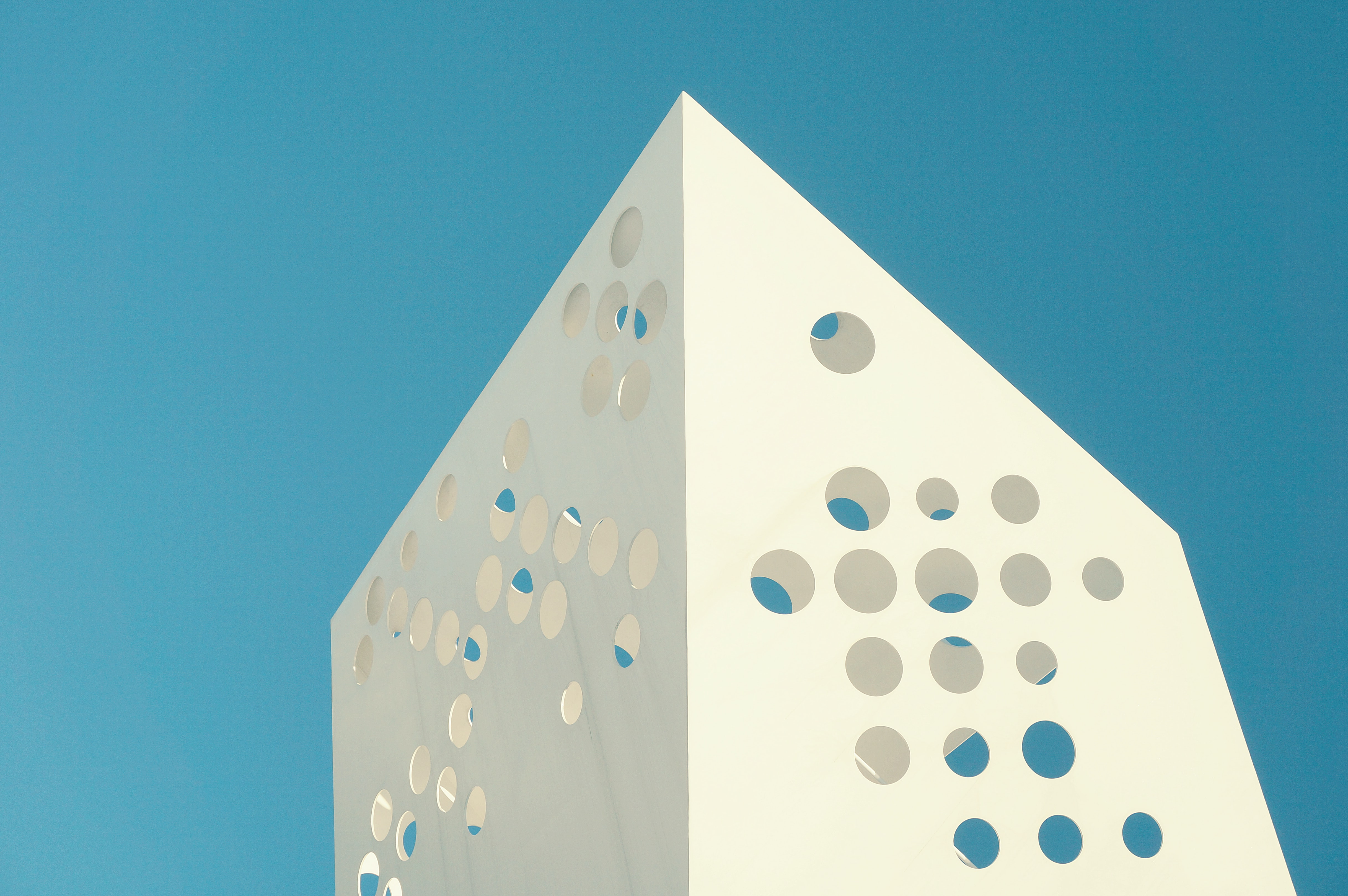 Unique design on a white building with holes in Denmark