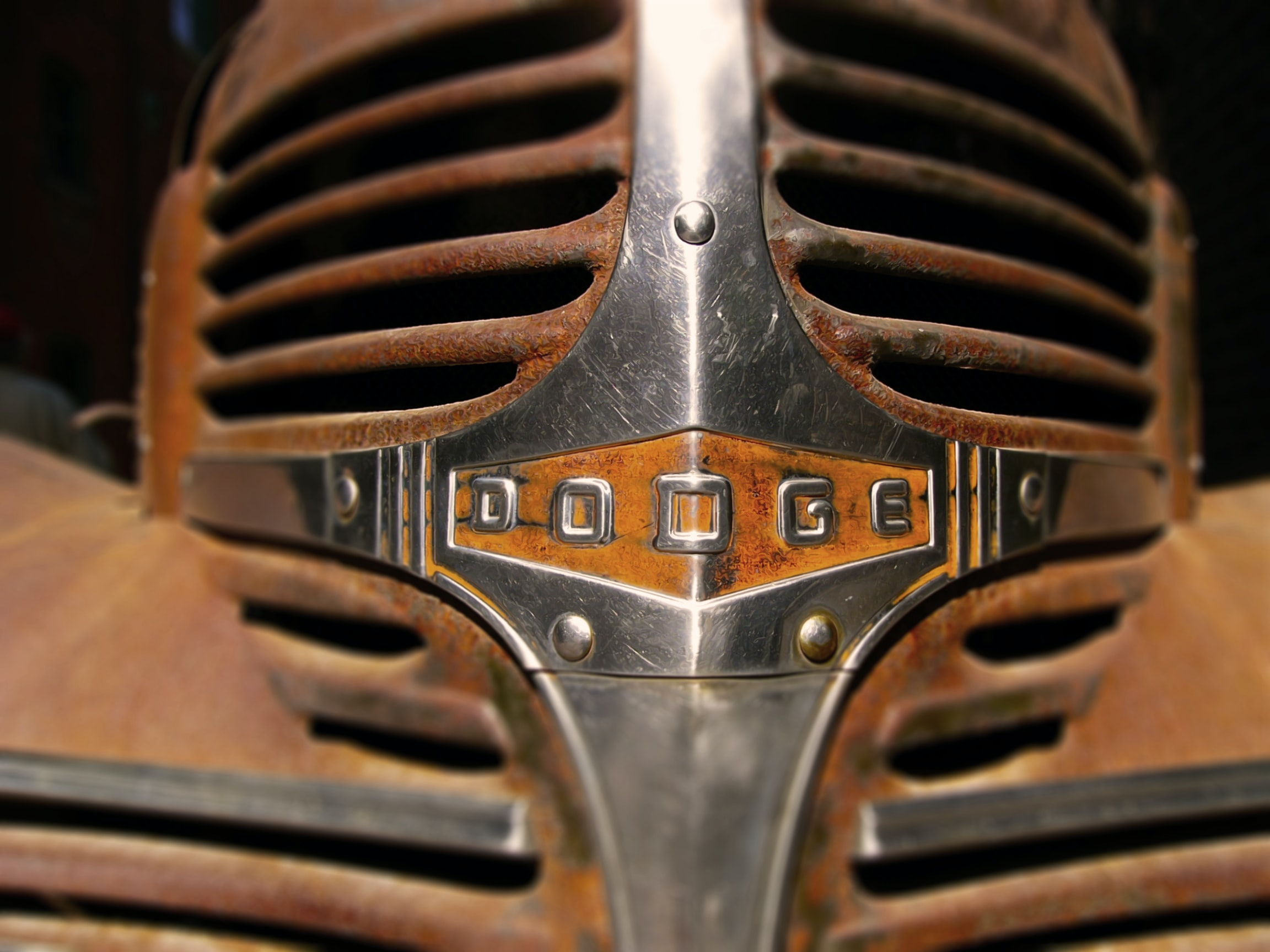 Rusty chrome grille of old dodge car.