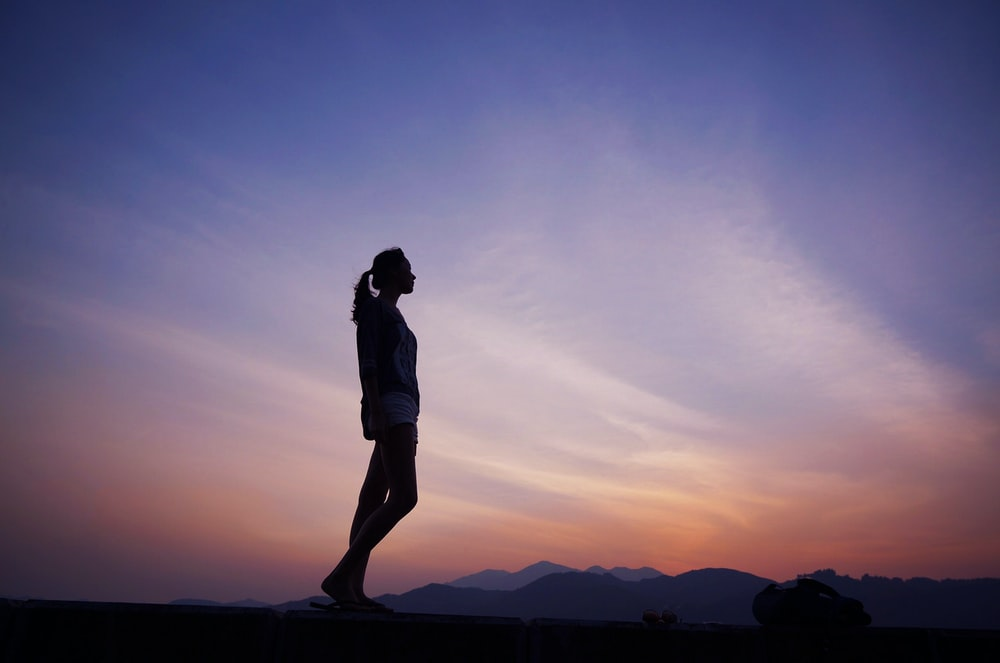 woman standing under blue sky