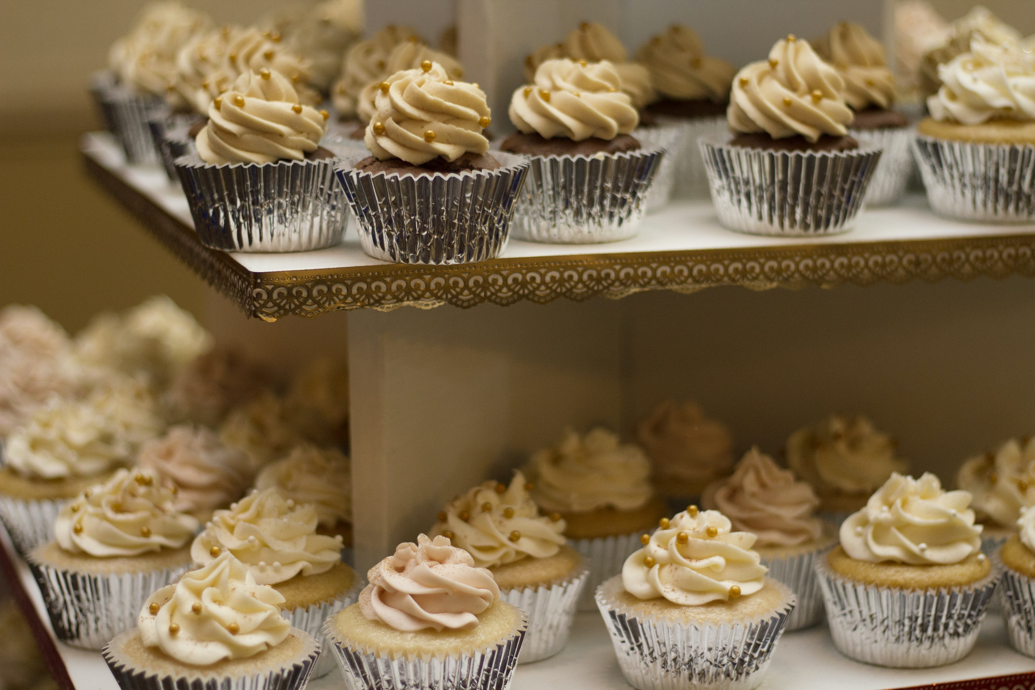 Tiers of mini cupcakes with caramel frosting