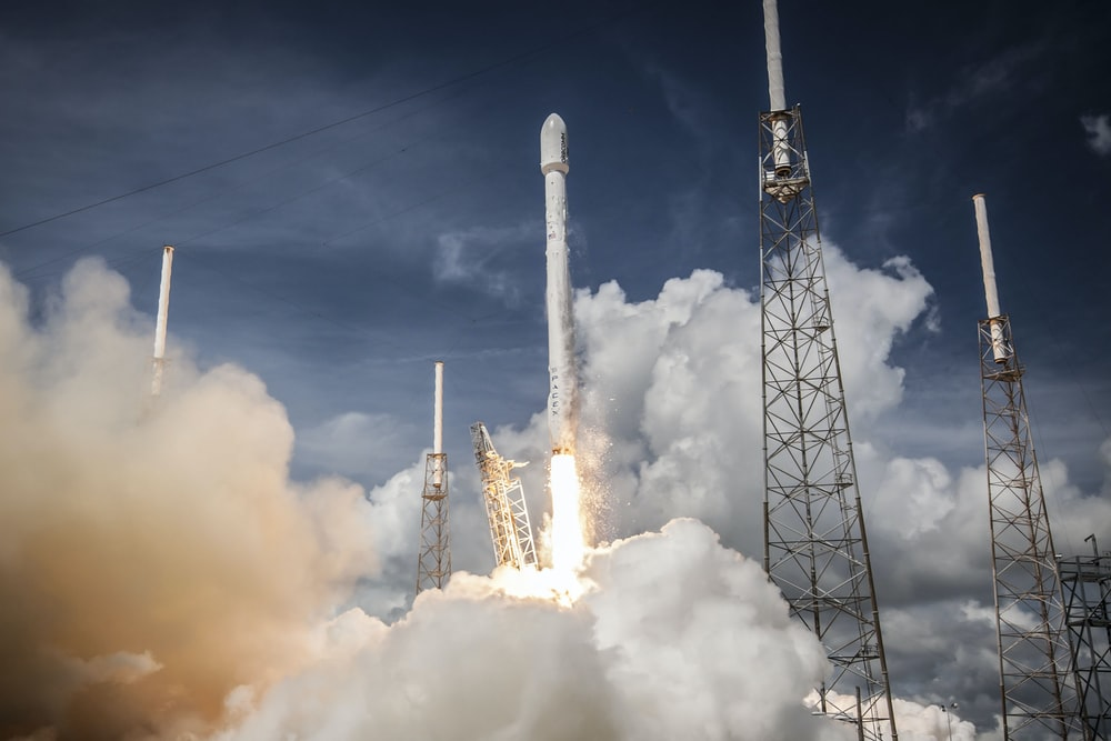 rocket launching with white smoke underneath