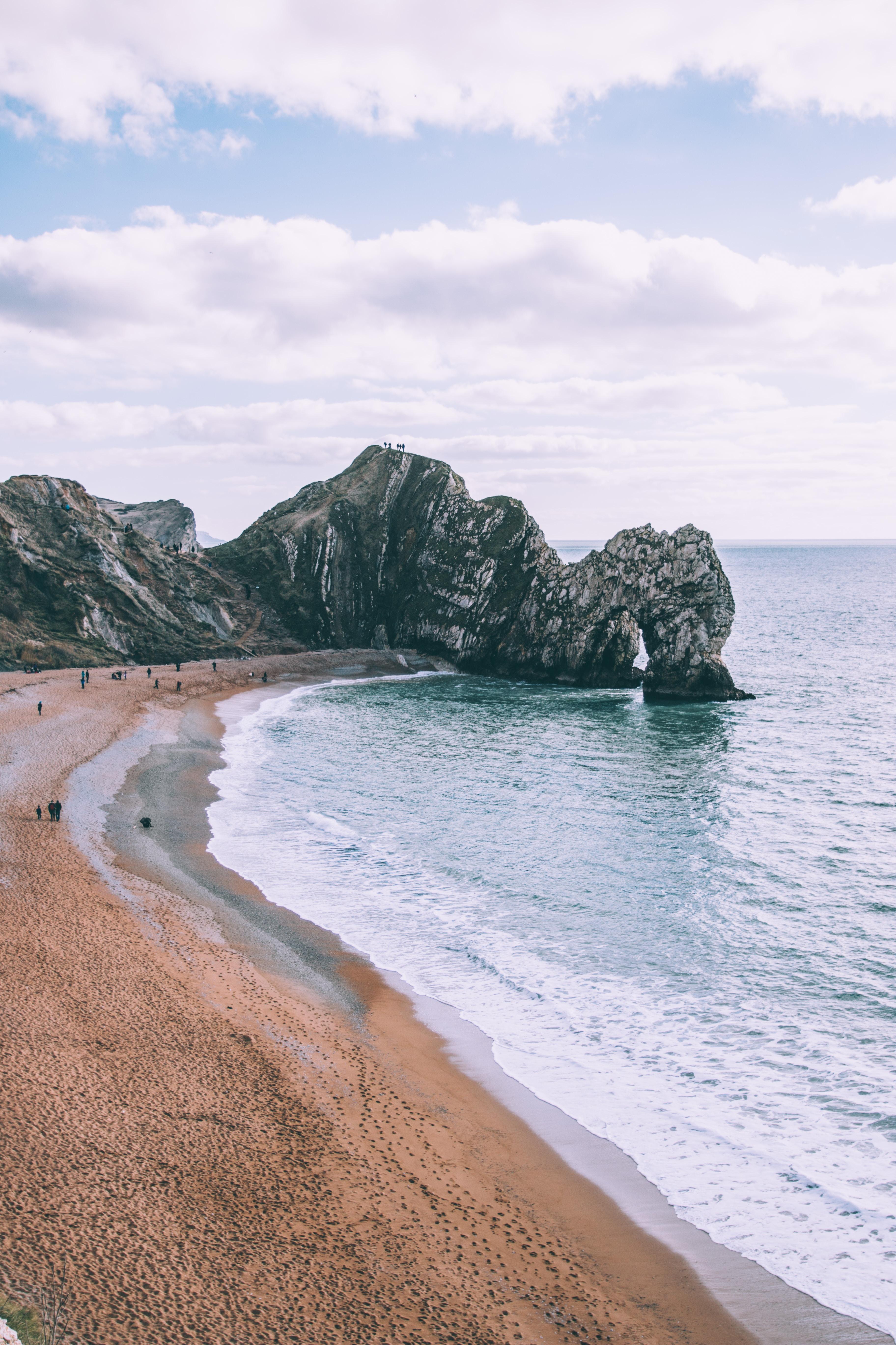Cliffs on the sand beach shoreline at Durdle Door