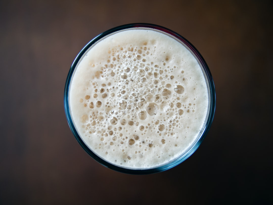 The top of a foamy drink.