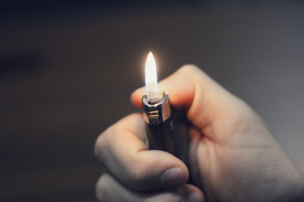 person holding black lighter