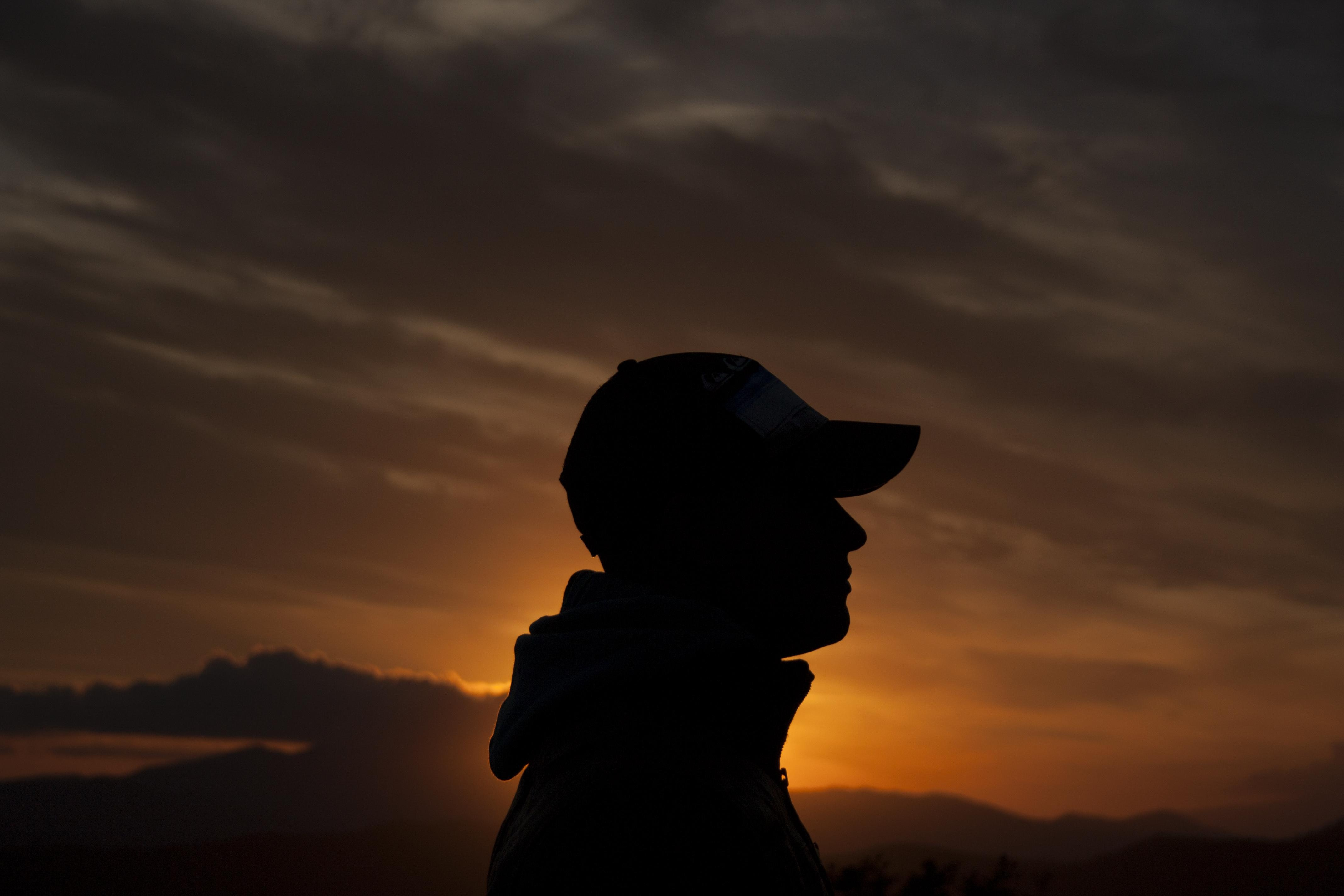 person's silhouette during golden hour