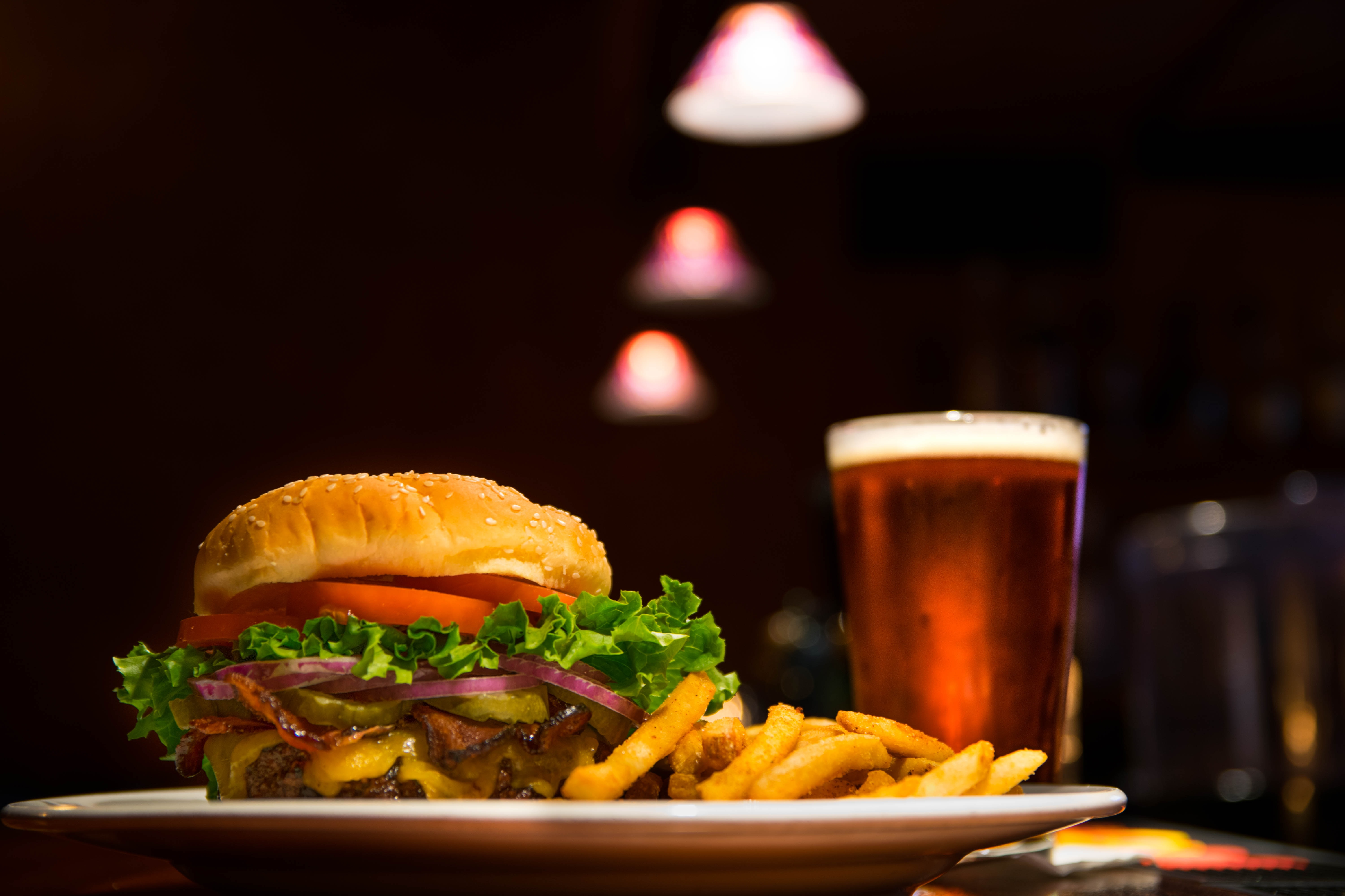 Late night cheeseburger, french fries, and a beer at the bar