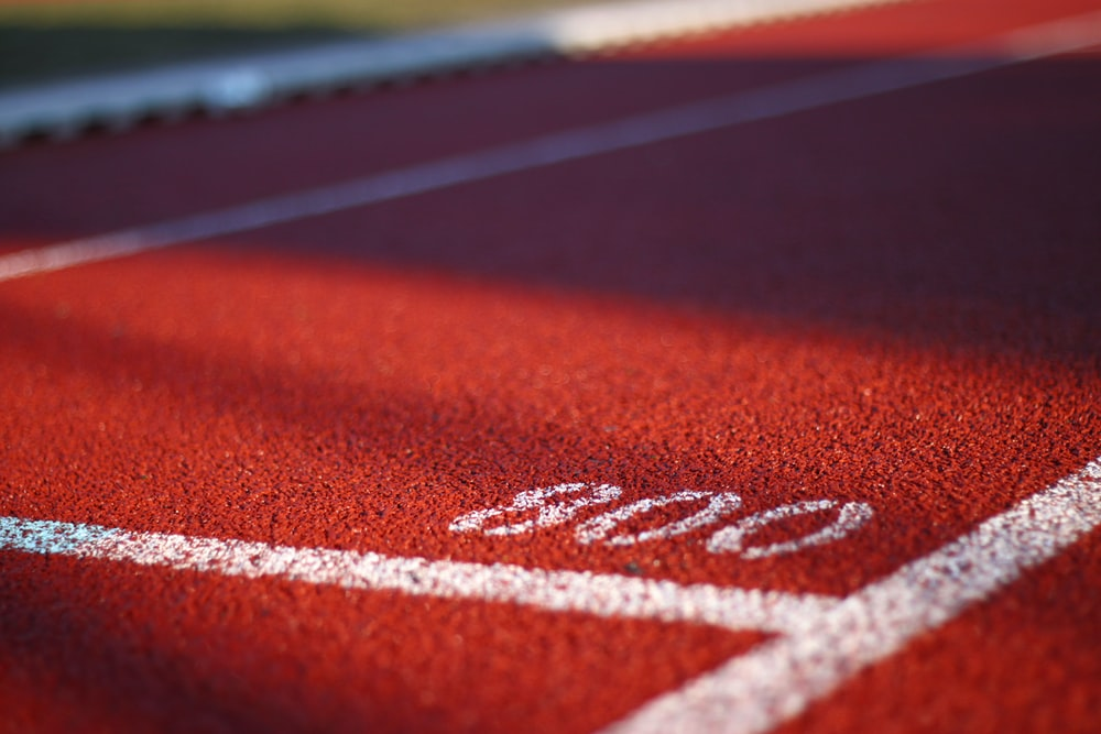 low angle photography of track field