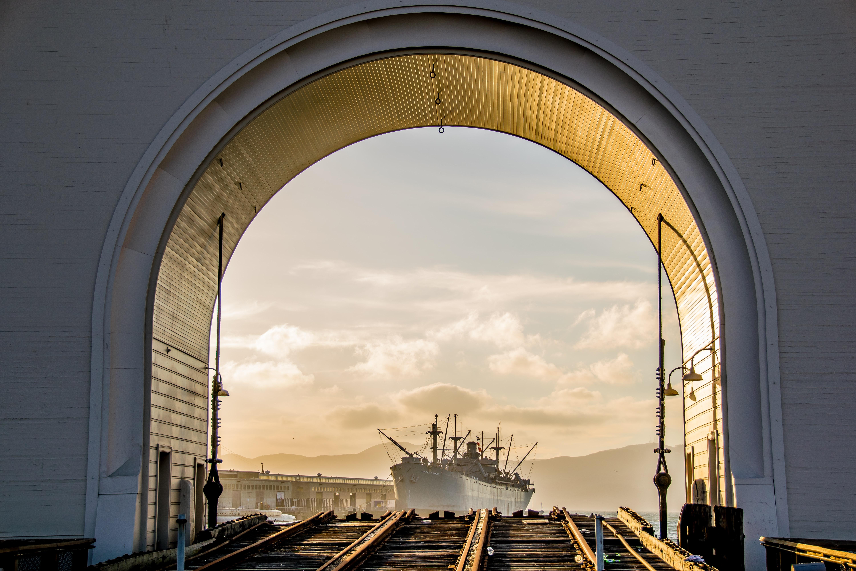 ship near tunnel during day
