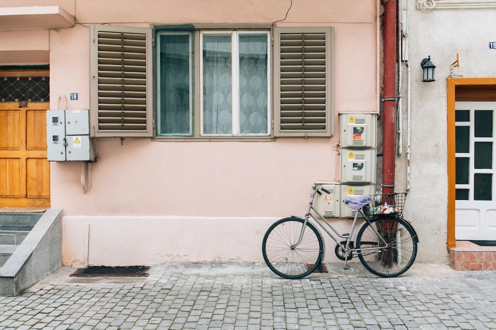 gray bicycle near house