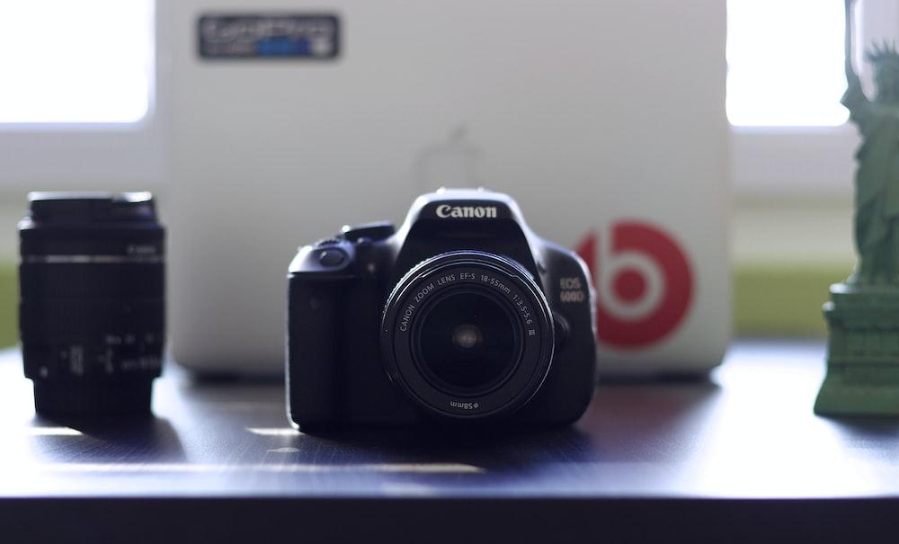 black Canon EOS on table