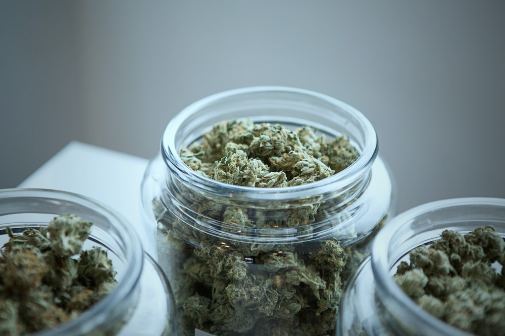 clear glass jar filled with kush