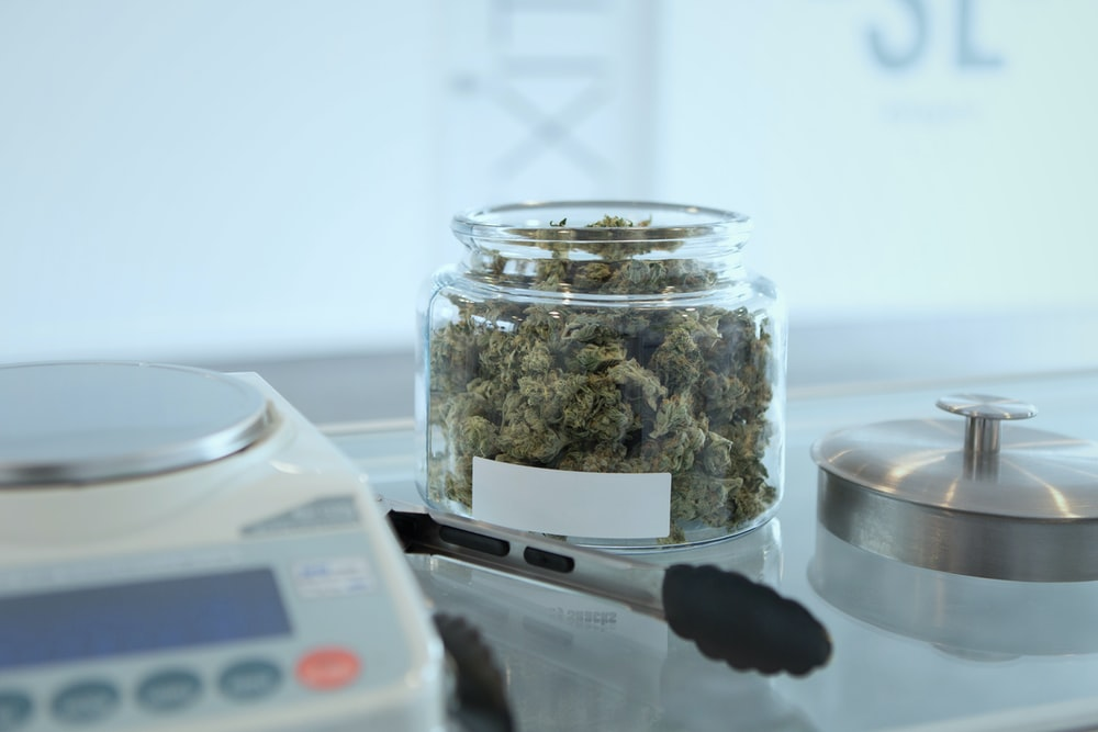 kush in jar with scale