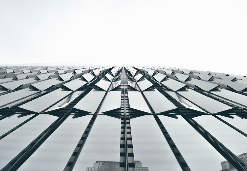 low angle photography of clear glass architectural design