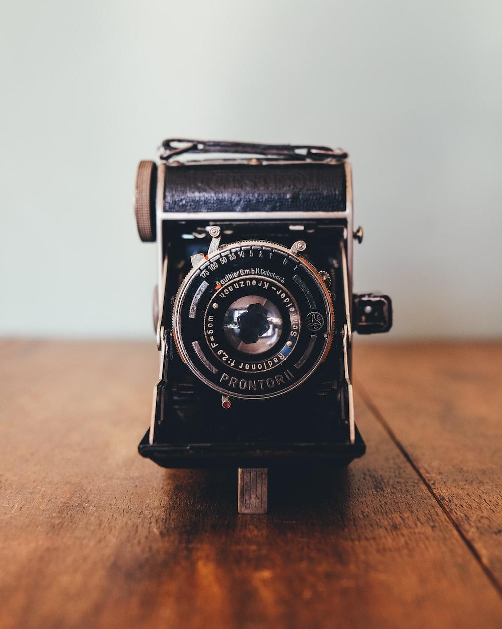 black Prontor II camera on brown wooden board