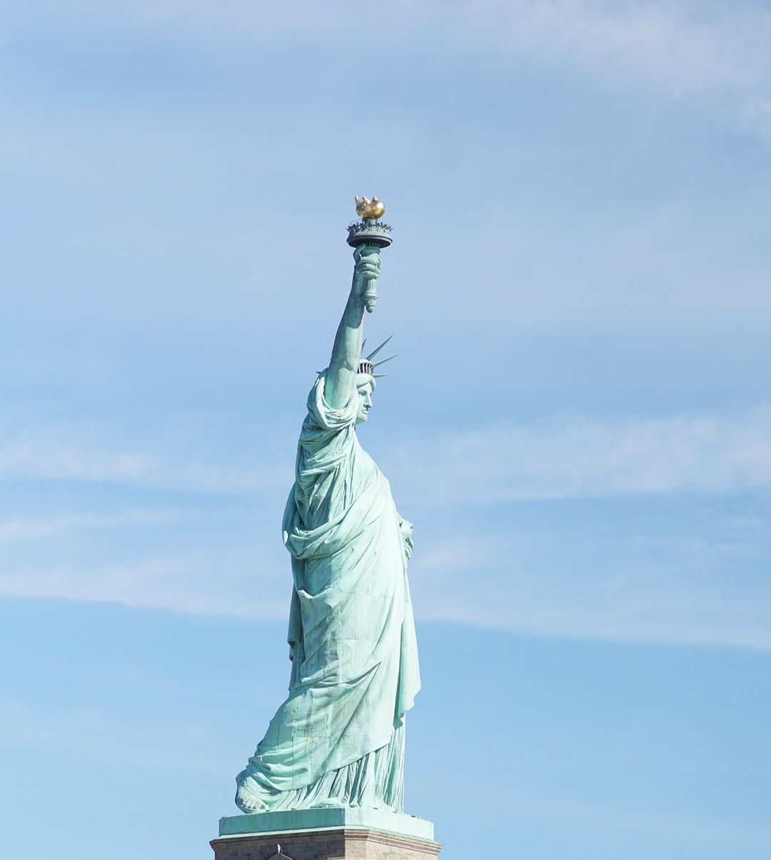 Statue of Liberty with clean blue skies behind the statue