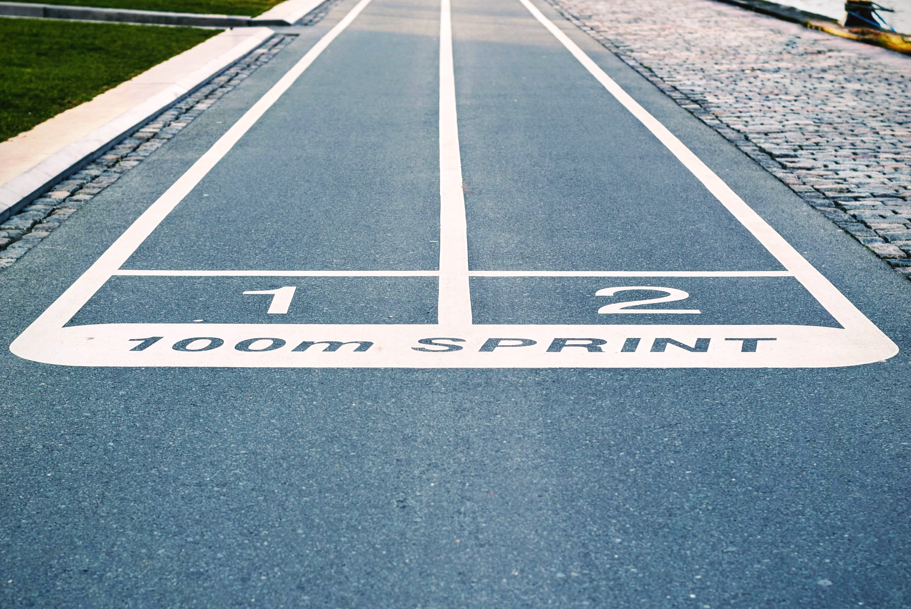 Two running lanes set up for sprinters to compete in a 100 meter race