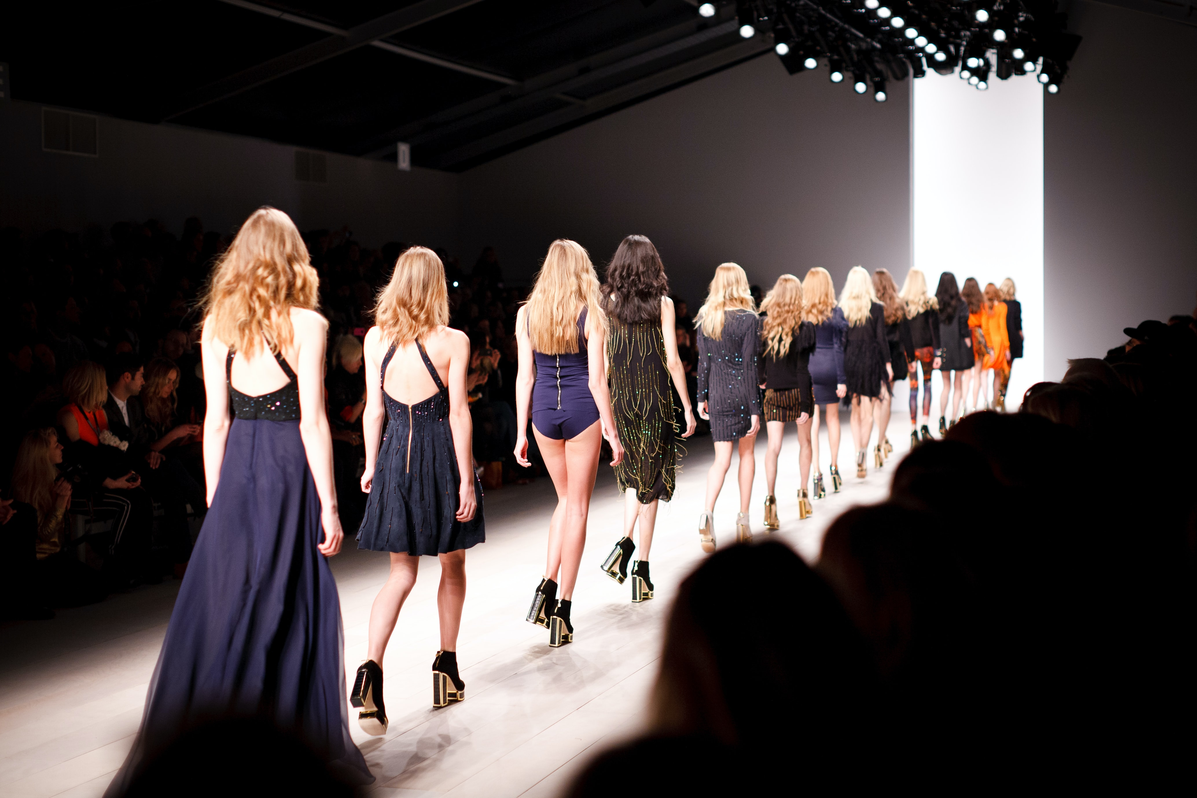 A long line of female models on the catwalk