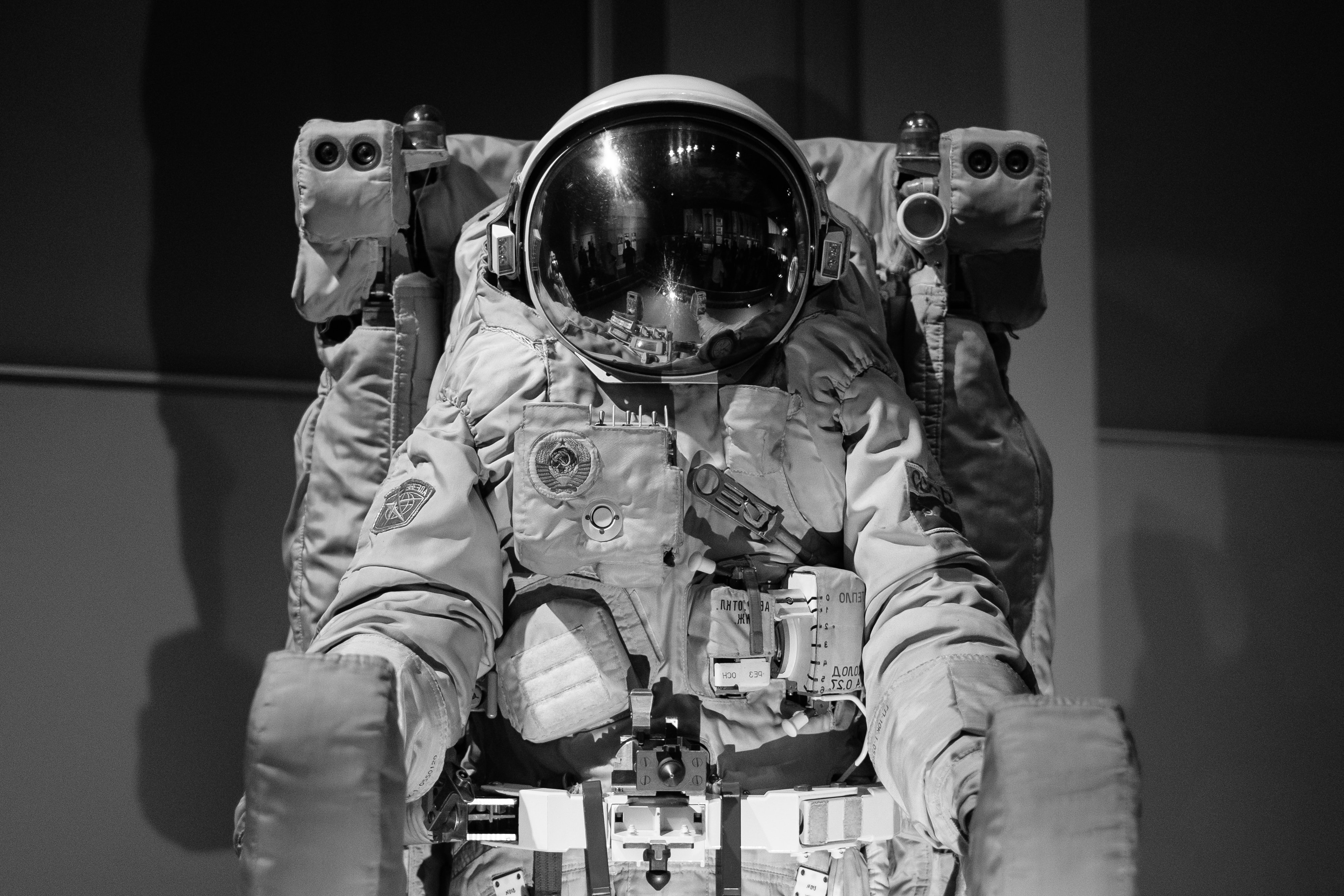 Black and white photo of an old astronaut suit displayed in the Science Museum in London