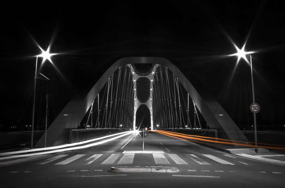 white and black bridge during night time